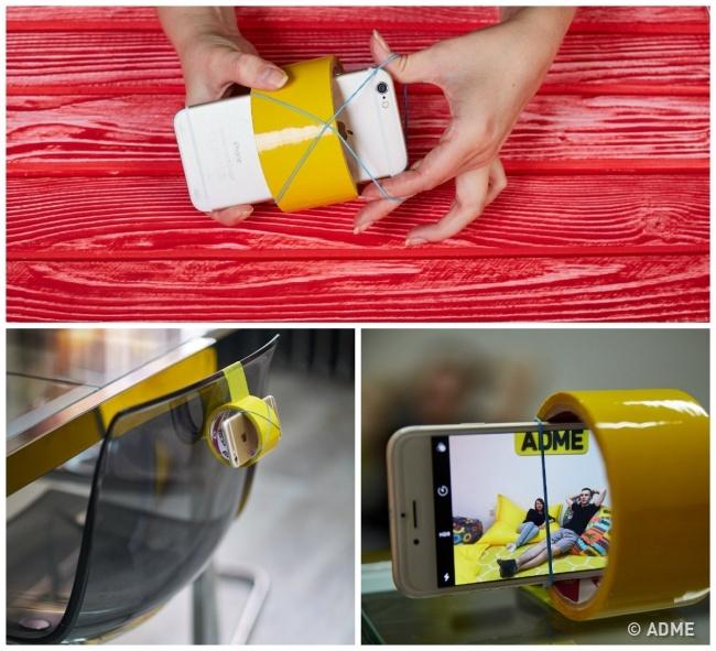 Возьмите упаковку широкого скотча, поместите внего телефон изакрепите его спомощью резинок, азат