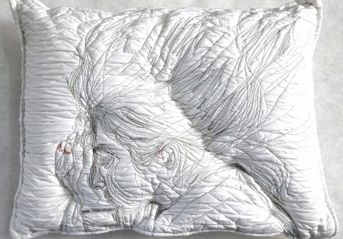 Sleeping People - She embroiders sleeping people on pillows