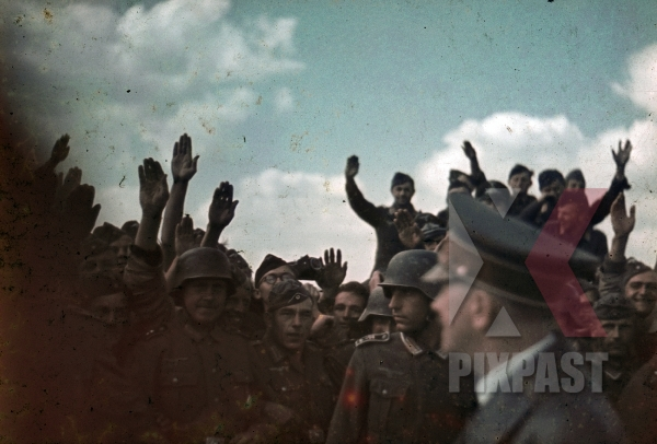 stock-photo-adolf-hitler-visit-troops-airport-ukraine-1941-helmet-salute-camera-security-7935.jpg