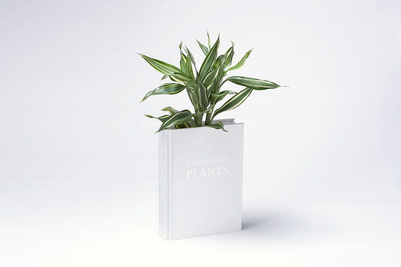 The Book vase by YOY Design Studio ( previously ) is a house planter camouflaged as a book. Made of