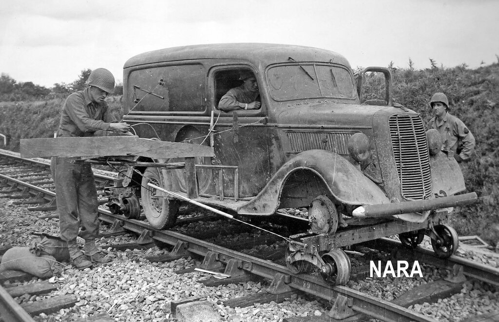 6th Armored Division outside Lorient with their invention, the 'Doodlebug'. This was a French civilian automobile (37 Ford Panel van) rigged with 750 pounds of high-explosive and modified to ride on railroad tracks at 25 mph.