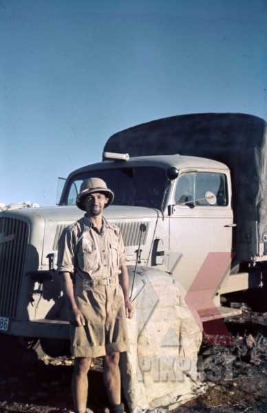 stock-photo-german-afrika-korp-soldier-in-front-of-a-supply-truck-north-africa-1942-9876.jpg