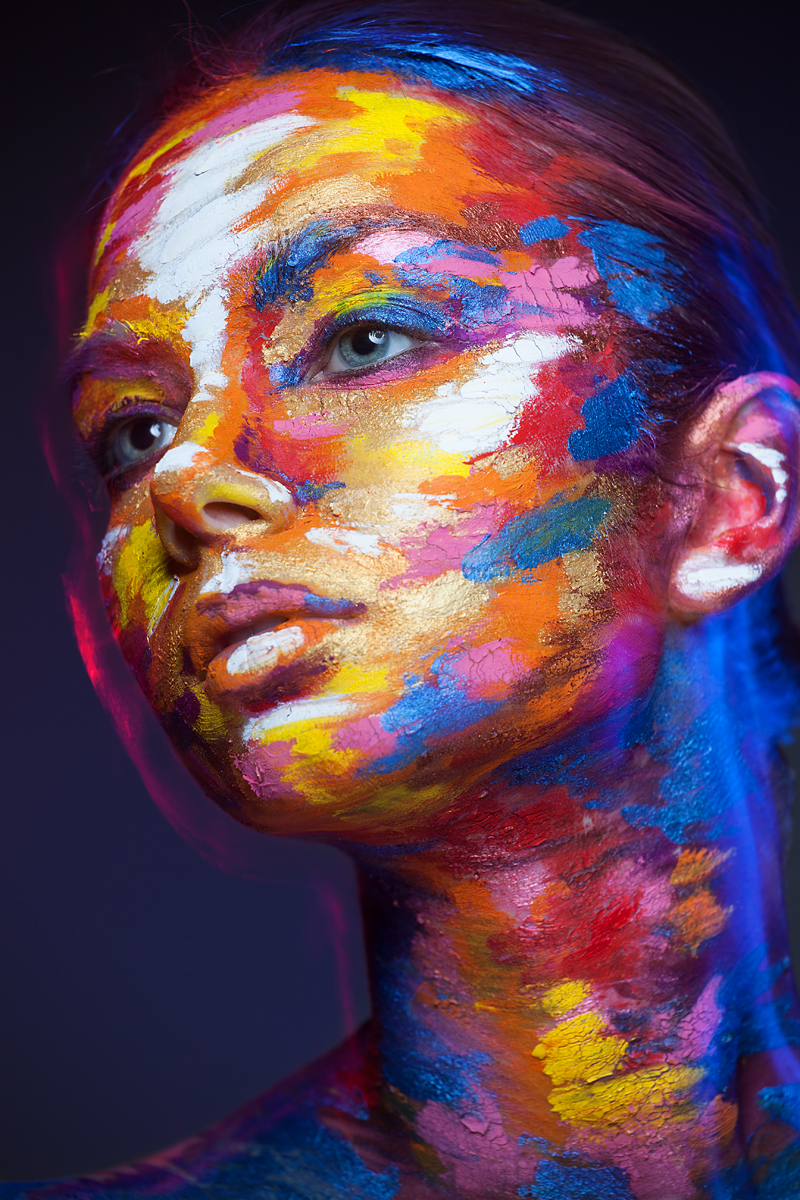 Faces of Models Transformed Into 2D Images with Face Paint