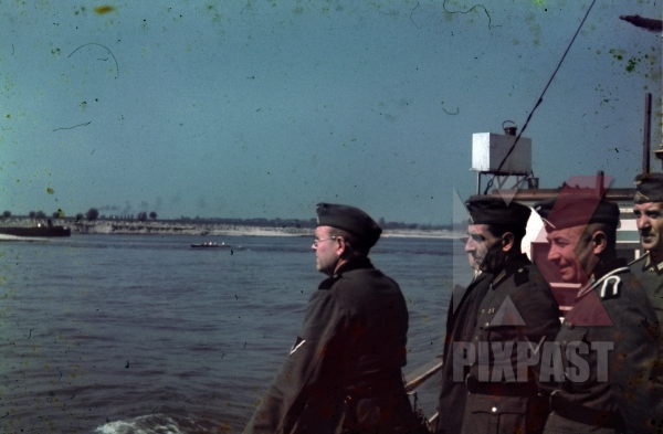 stock-photo-german-soldiers-on-ferry-boat-on-the-river-seine-near-paris-france-1940-rowing-boat-canal-boat-11800.jpg