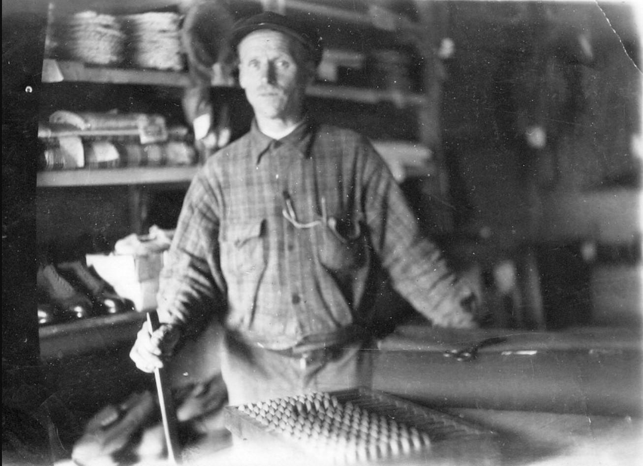 Степан Петрович Панфилов за прилавком в магазине
