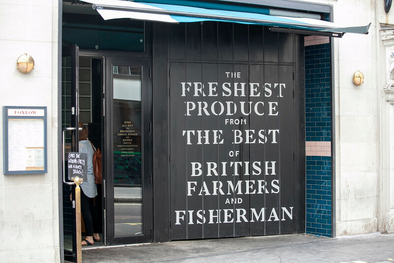 Black door Entrance to the farmer and fisherman market near Piccadilly Circus