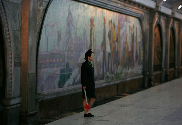 A North Korean station master waits for a train at a metro station in Pyongyang August 27, 2007. (Ph