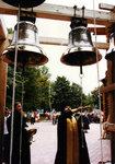 Игумен Меркурий (Иванов) освящает колокола звонницы малого собора Христа Спасителя.