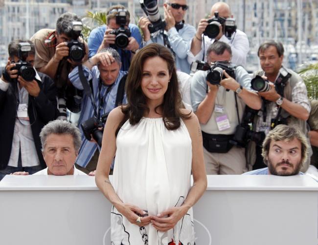 © REUTERS/Jean-Paul Pelissier  Главное вмастерстве делать фотобомбы— нерассмеяться. Анджели