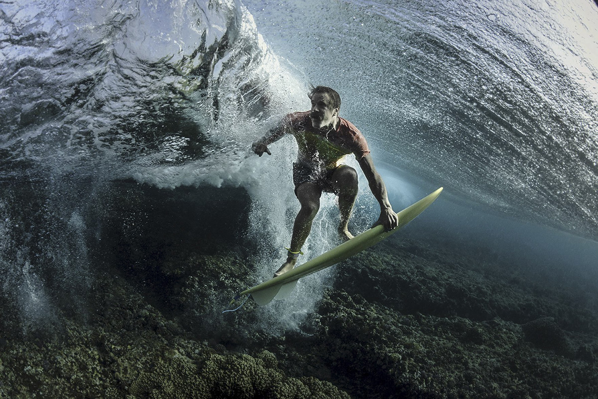 People, 3rd place. Photo and caption by Rodney Bursiel . Under The Wave . I recently traveled to Tav