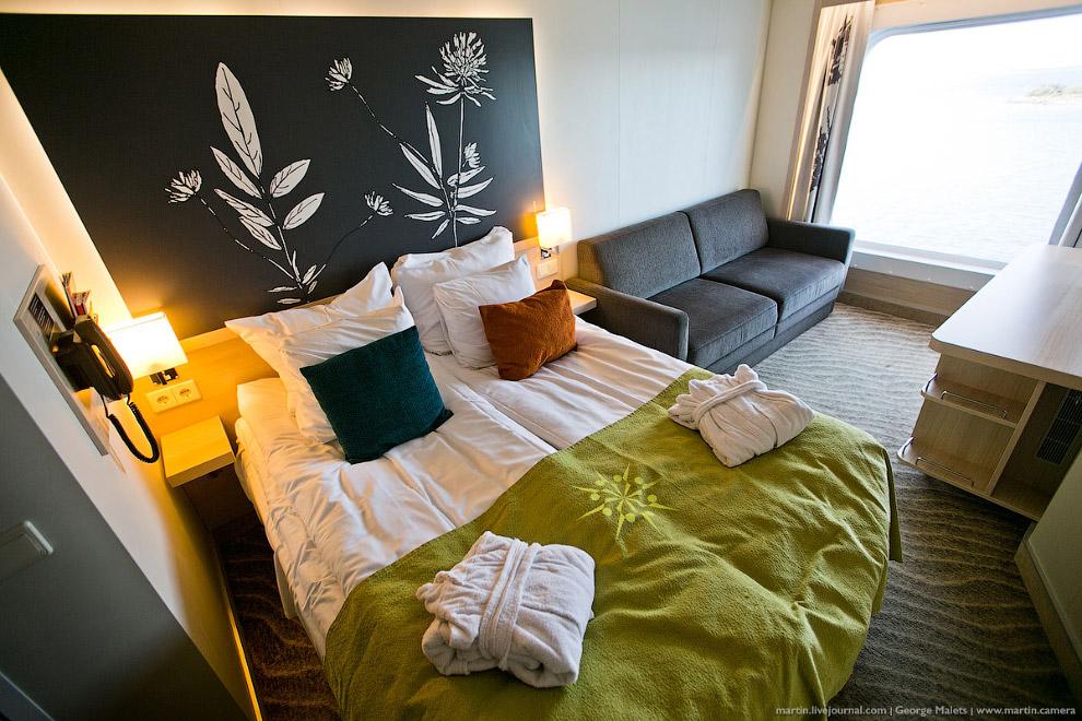 30. Каюта Suite Flow с видом на море. Двуспальная кровать и диван-кровать для детей до 18 лет.