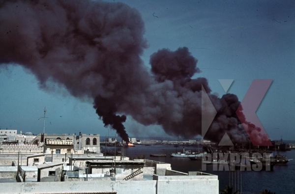 stock-photo-tripoli-harbour-in-libya-1942-destroyed-burning-german-transport-ships-after-allied-air-attack-11241.jpg