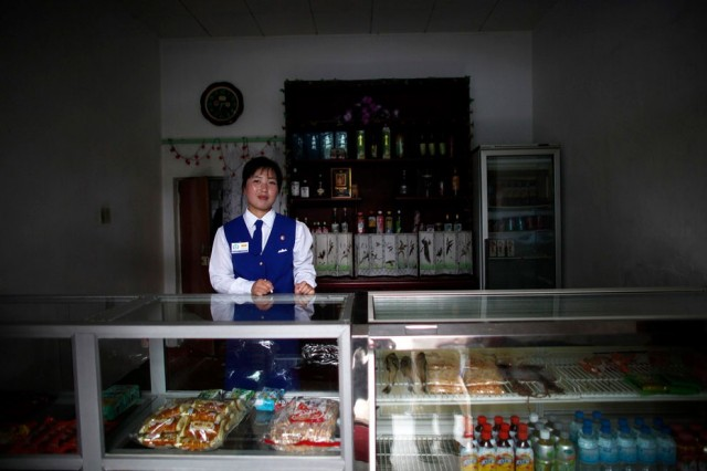 A vendor stands inside a shop at the North Korean Special Economic Zone of Rason City in Rajin, nort