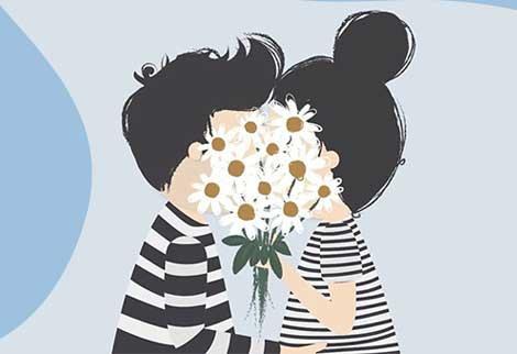 Мальчик с девочкой целуются за букетом цветов