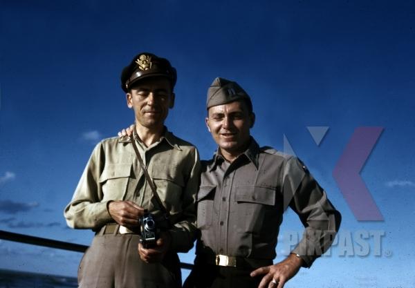 stock-photo-2-american-air-force-captains-with-cine-kodak-eight-model-60-8mm-home-movie-camera-tripoli-libya-1945-13154.jpg