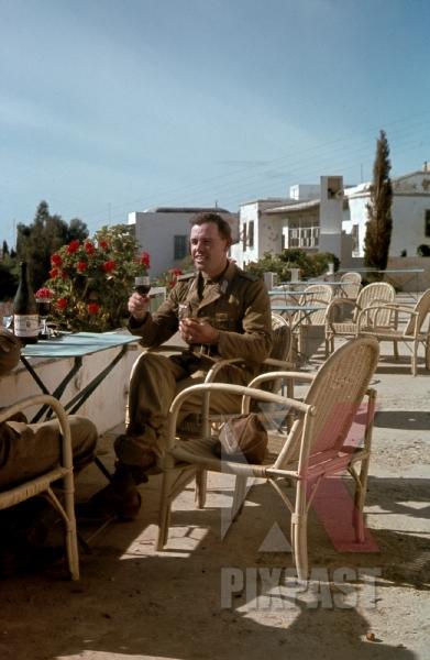 stock-photo-german-war-photographer-fritz-moosmgvller-drinks-wine-beside-leica-iii-camera--apartment-balcony-karthago-tunesien-1942-12458.jpg