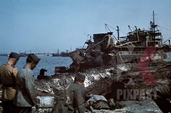 stock-photo-tripoli-harbour-in-libya-1942-destroyed-burning-german-transport-ships-after-allied-air-attack-11240.jpg