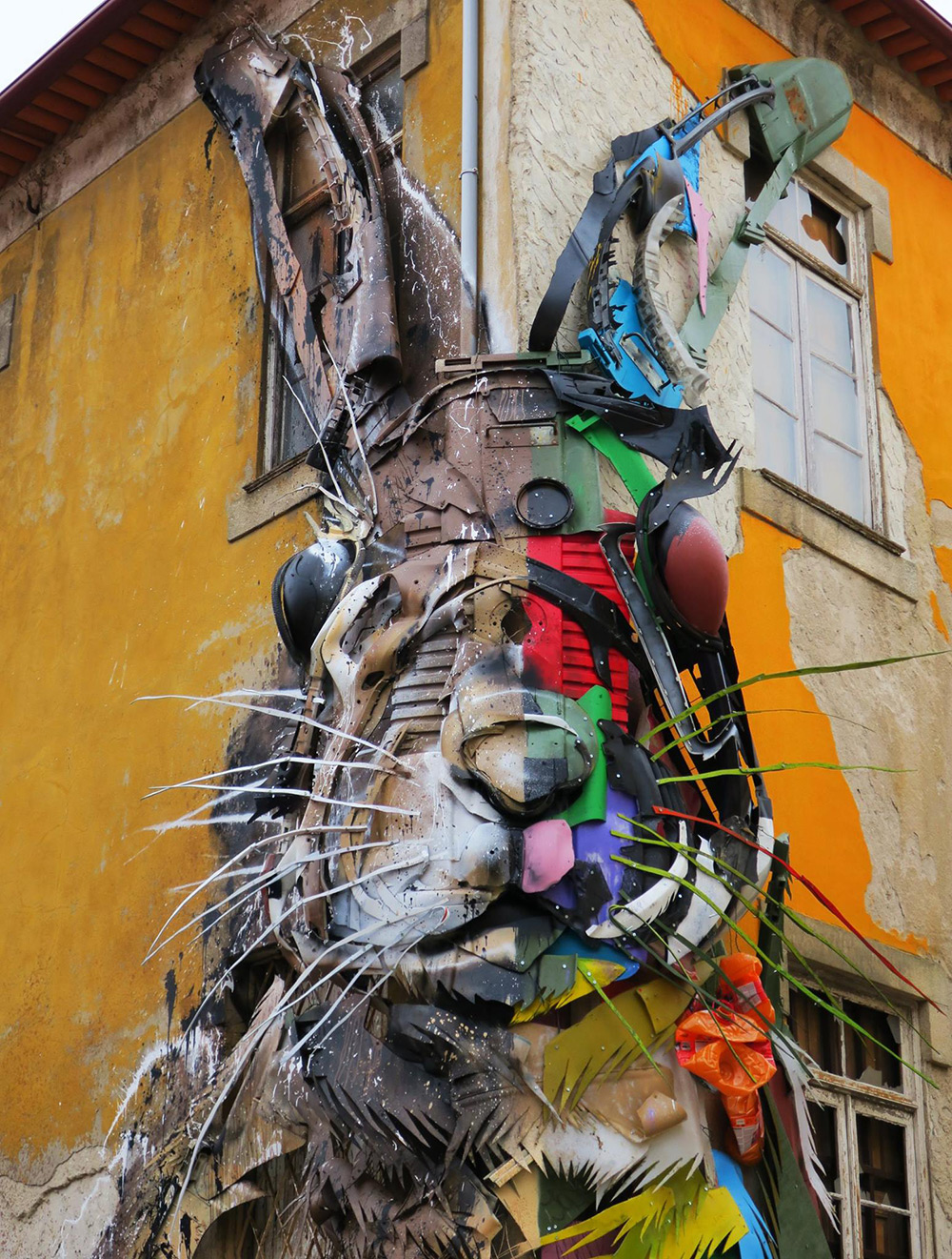 Bordalo II ( previously ) has created a series of bisected animals, colorful plastics forming one ha