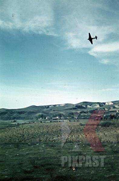 stock-photo-german-luftwaffe-reconnaissance-airplane-flying-over-greek-village-greece-1941-9977.jpg