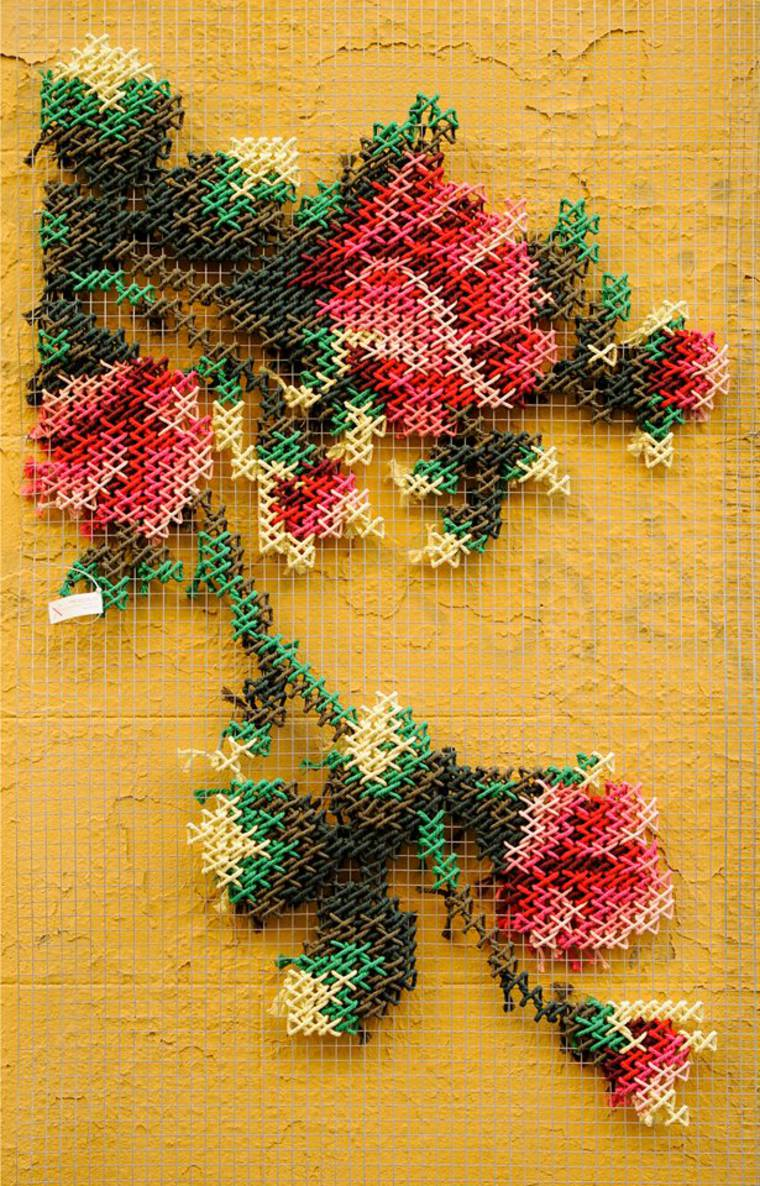 The foral cross-stitch street art by Raquel Rodrigo is beautiful and poetic
