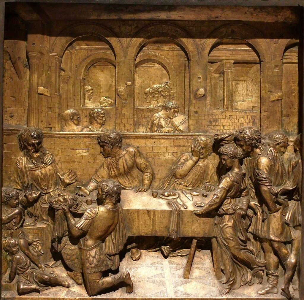 Baptismal_font_of_the_Siena_Baptistry_la-test_battista_presenta.jpg