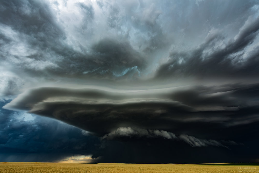 A supercell thunderstorm looms menacingly above a wheat field in Nebraska on June 27, 2016.