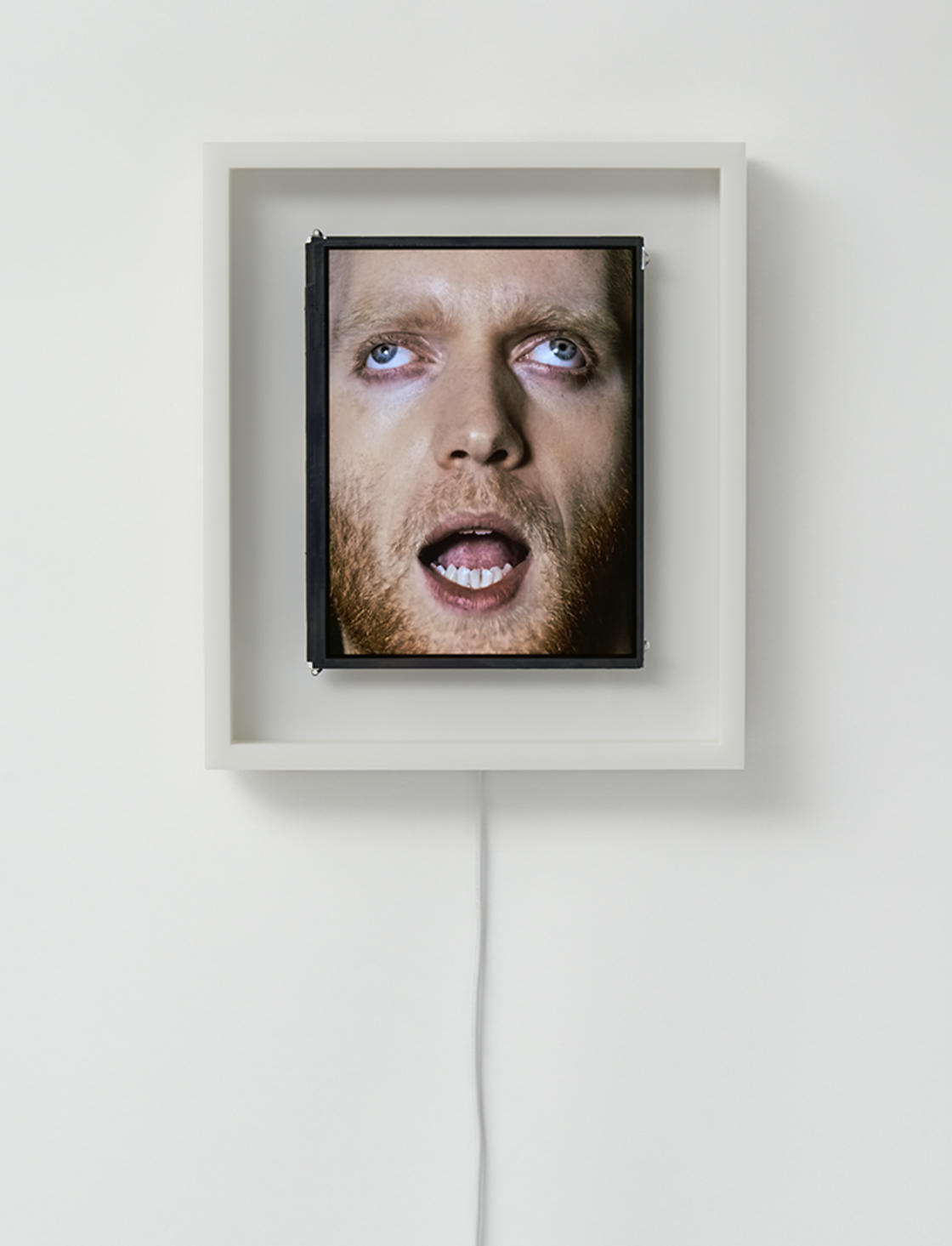 These weird clocks use human faces to display the time