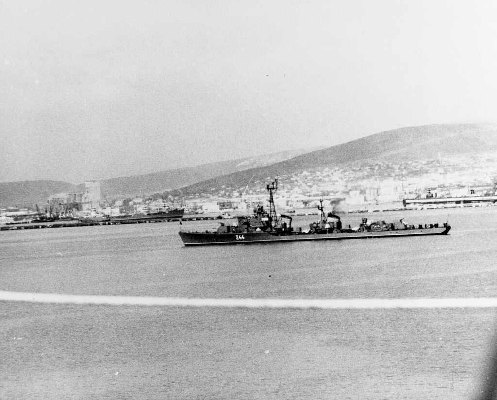 Soviet SKORYY Class Destroyer, photographed during mid-1961, probably at a Black Sea port, note the large floating dry dock visible at the right, marked ~Slow speed~ in both Russian and English letters.
