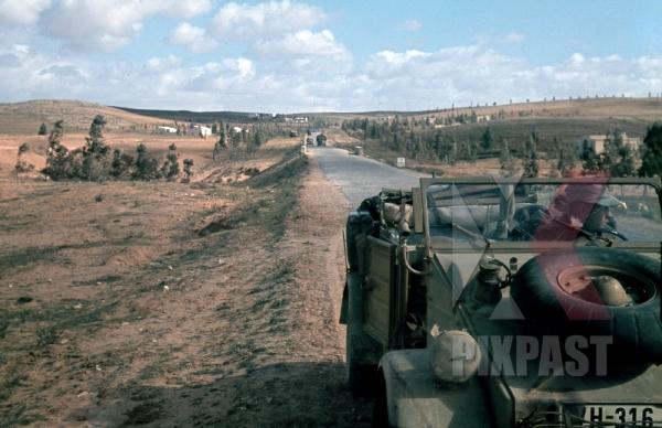 stock-photo-german-afrika-korp-war-reporter-sitting-in-his-army-jeep-volkswagen-kgvbelwagen-82-tarhuna-libya-1942--12449.jpg