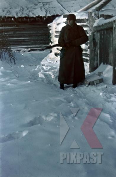 stock-photo-german-guard-sentry-winter-jacket-mantel-helmet-stahlhelm-m40-and-kar98-rifle-in-russian-winter-snow-1944-10025.jpg