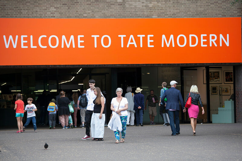 Entrance to the Tate Modern Museum. Spiritual people leave the museum.