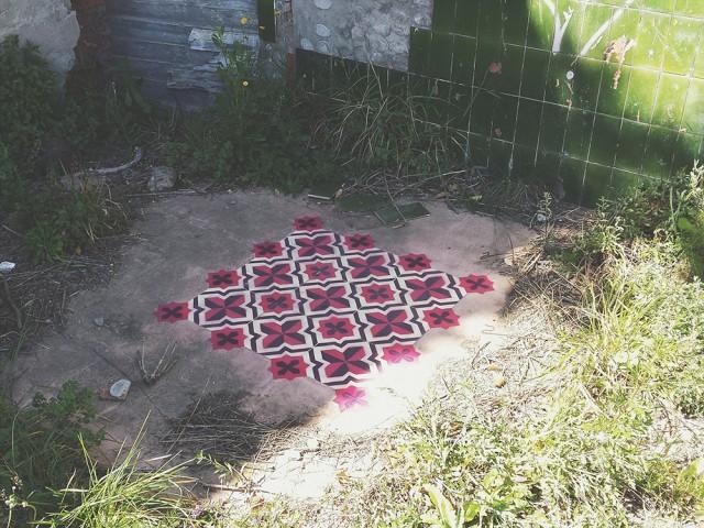 Geometric Tile-Like Patterns Sprayed on Floors in Abandoned Buildings