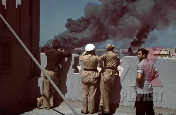 stock-photo-tripoli-harbour-in-libya-1942-destroyed-burning-german-transport-ships-after-allied-air-attack-11244.jpg