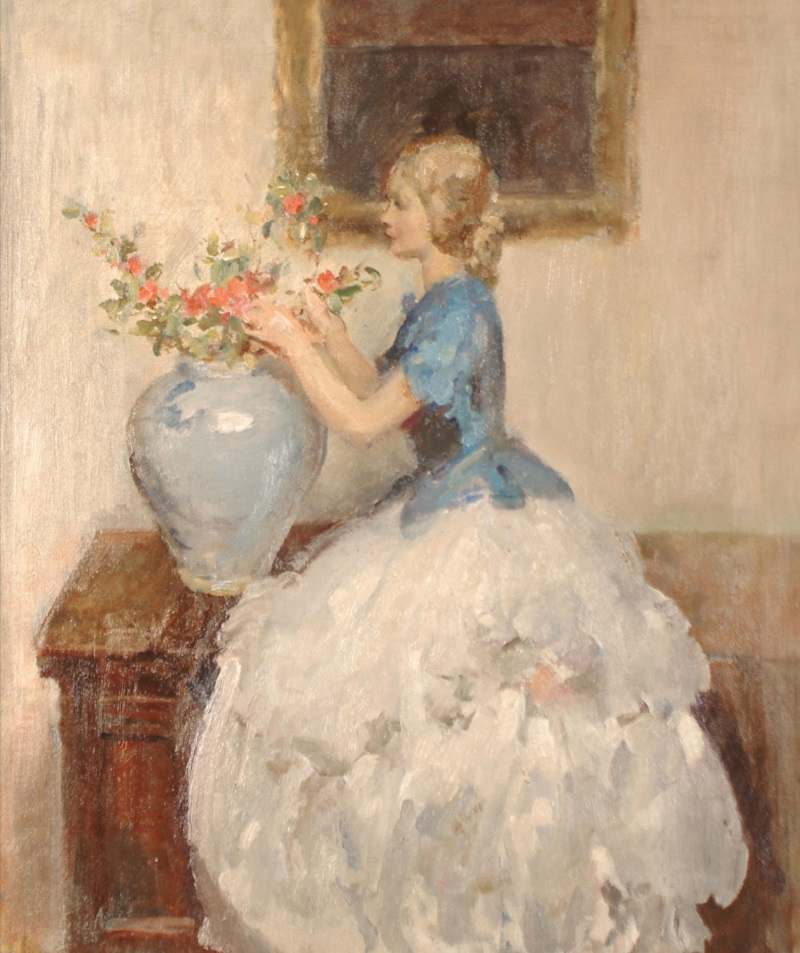 Woman tending to flowers in a vase