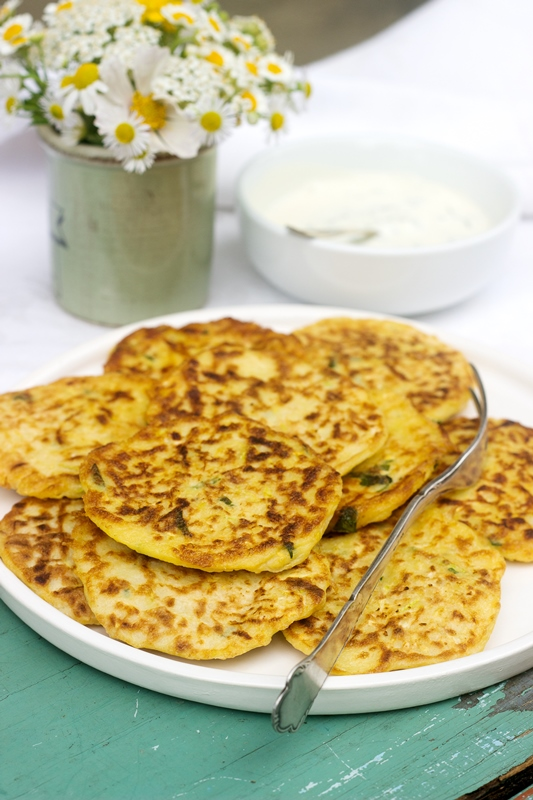 Zucchini fritters, vegetable pancakes, rustic style, selective focus