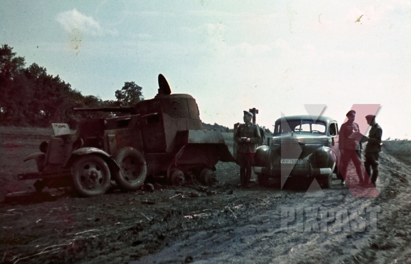 stock-photo-opel-kapitan-saloon-car-beside-destroyed-captured-russian-ba10-soviet-armoured-car-ukraine-1942-7925.jpg
