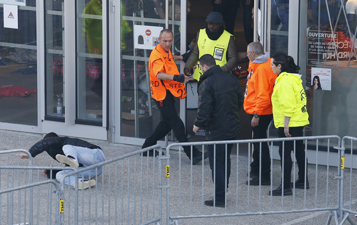Stewards and a fan before the match