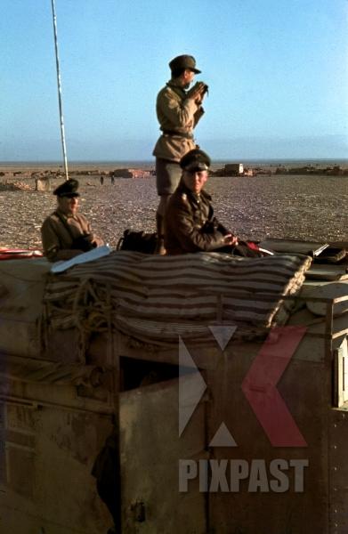 stock-photo-field-marshal-erwin-rommel-watching-battlefield-1941-tunisia-in-captured-british-armoured-truck-max-mammut-12494.jpg