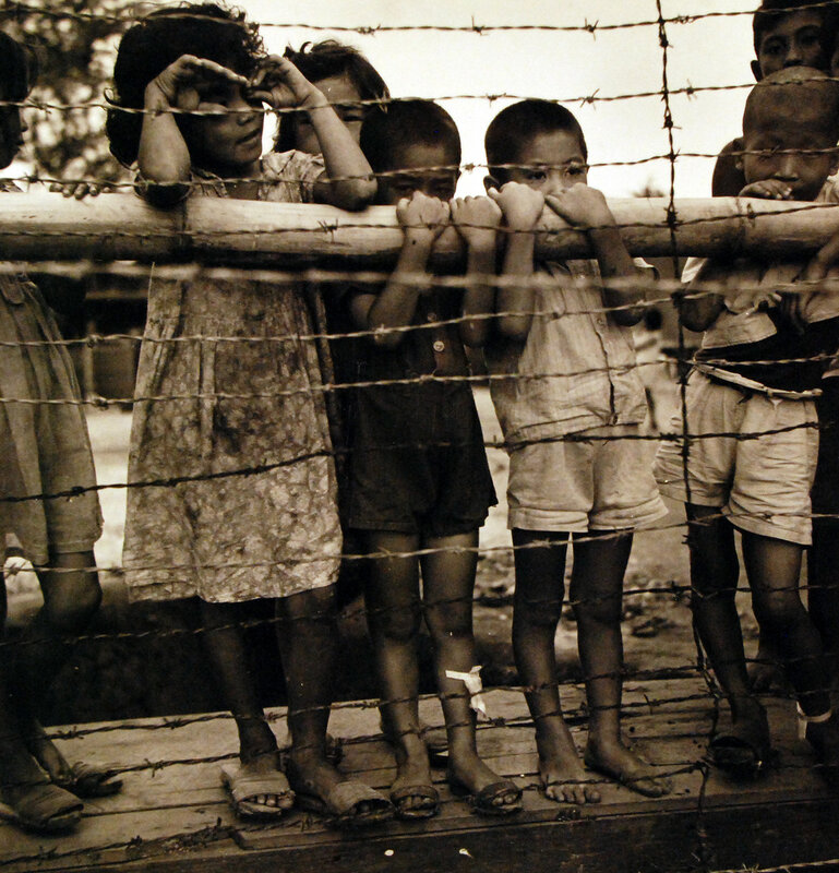 Battle of Guam. Children of Japanese sympathizers in prison stockade on Guam. Photographed by Lieutenant Wayne Miller, November 1944.