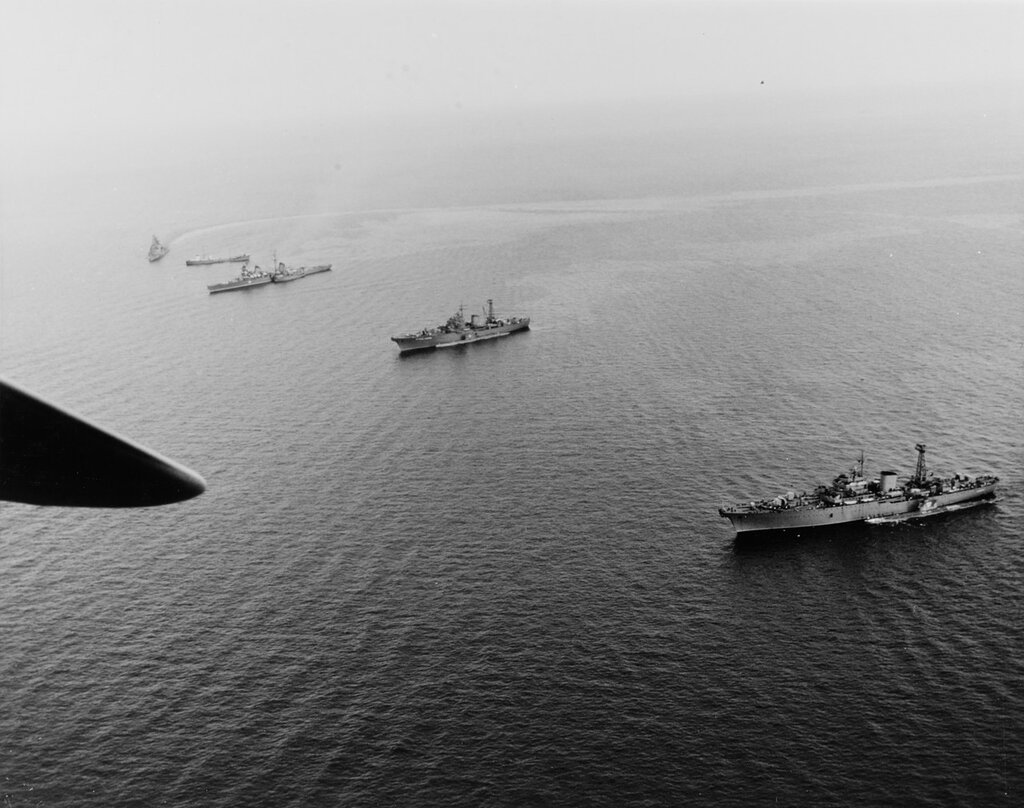 Soviet Warships in the Mediterranean off Crete, 5 June 1967. The ships present include two Don-class submarine tenders with submarines alongside, the Kirov-class cruiser SLAVA (ex-MOLOTOV), a small merchant-type ship, and a Kashin-class guided mi