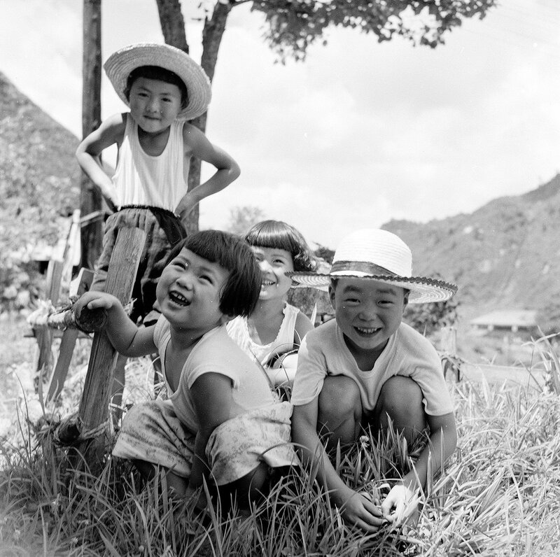 Children in Hats Smiling - 1950s Japan