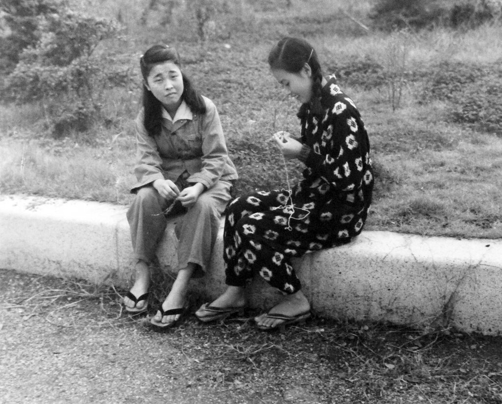 Scene at Sasebo, Kyushu, shows Japanese girls. October 19, 1945