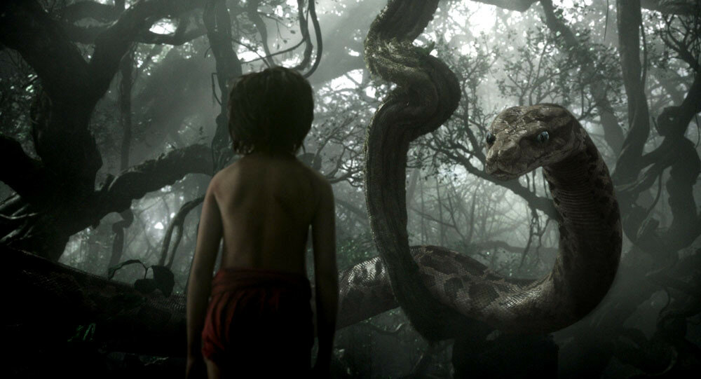 Mowgli (newcomer Neel Sethi) meets Kaa (voice of Scarlett Johansson) in ?The Jungle Book,? an all-new live-action epic adventure about Mowgli, a man-cub raised in the jungle by a family of wolves, who embarks on a captivating journey of self-discovery whe