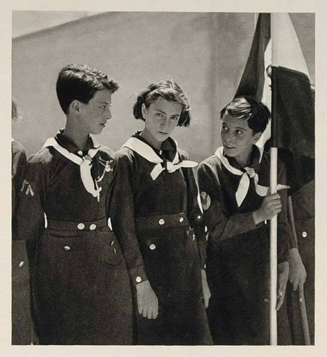 Young Iranian Girl Scouts prepare for parade in their uniforms. (Circa 1940's-1950's).jpg
