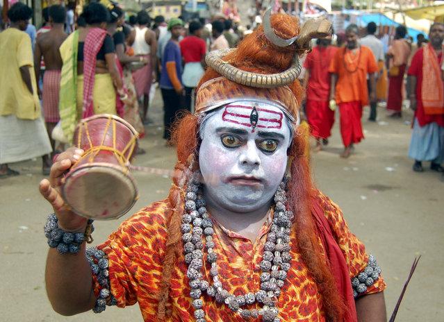 A Sadhu or Hindu holy man dressed as Lord Shiva is seen at Kamakhya temple in Guwahati, Assam, June