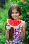 Portrait of a young little girl with watermelon