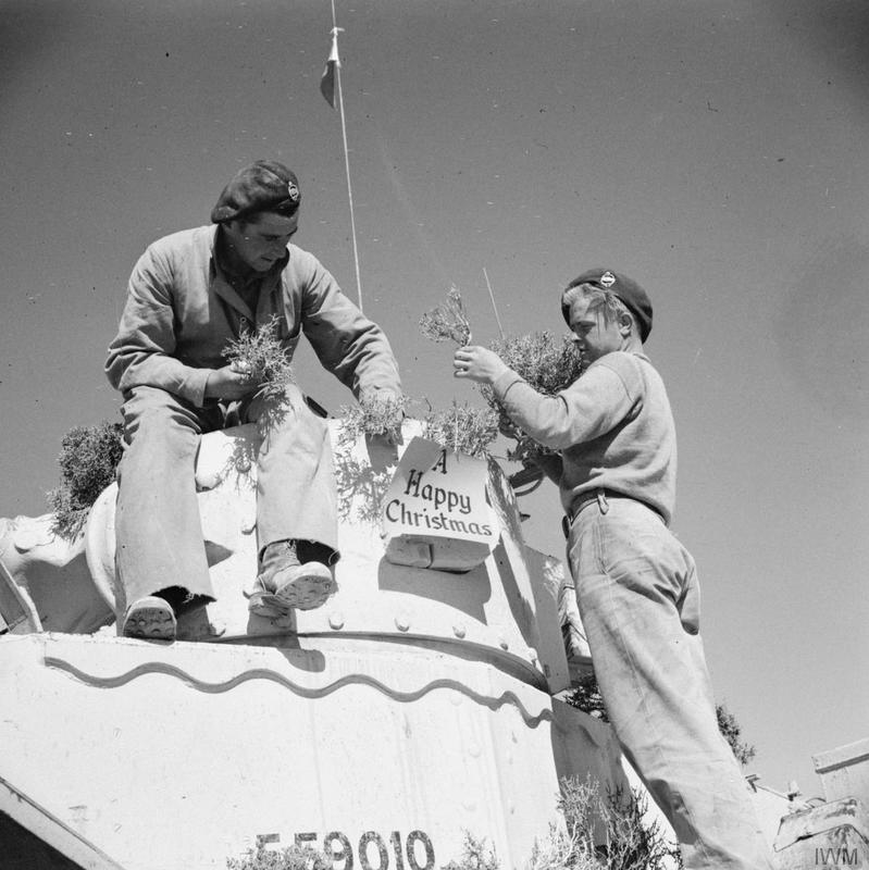 A Valentine tank crew decorate their vehicle for the festive season with camelthorn in place of holly, 17 December 1942