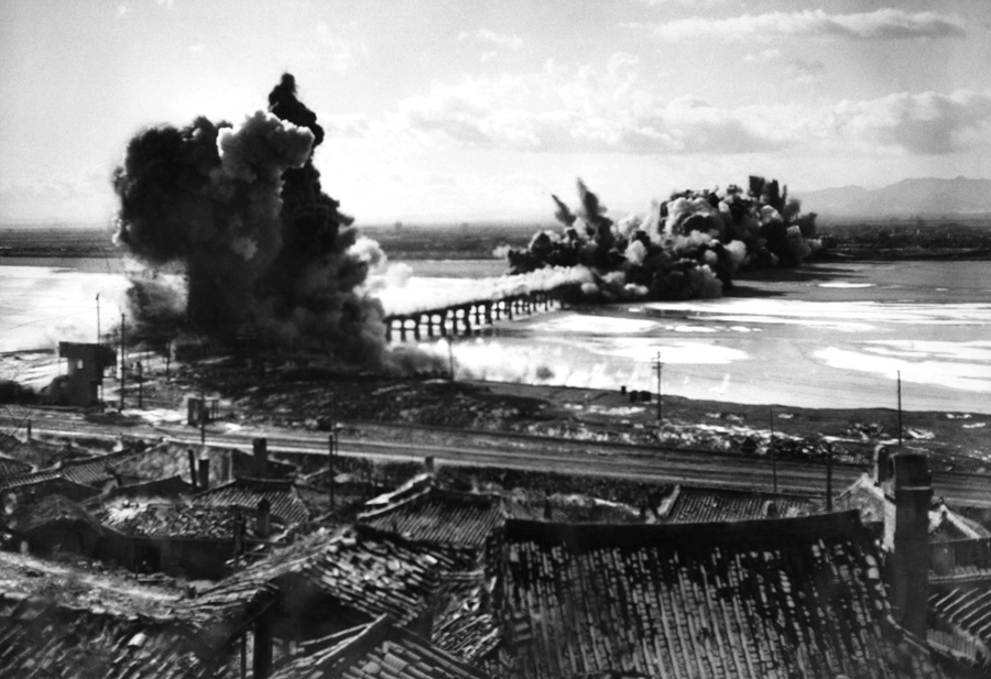 The Songchon River bridge into Hamhung is destroyed by demolition teams to slow the advance of Commu