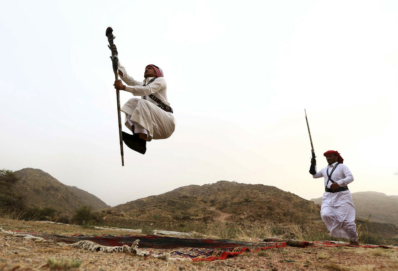 Men dance during a traditional excursion near the western Saudi city of Taif