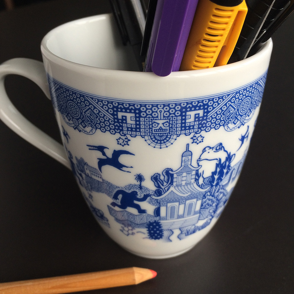 Rendered in a style mimicking traditional blue willow pattern design, artist Don Moyer illustrated t